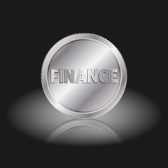 Symbol finance in coin. Finance text on silver coin with shadow on a black background.