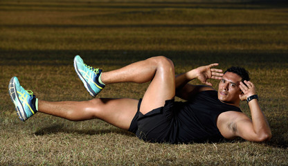 man exercise abs on grass