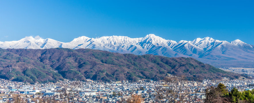 Panorama cityscapoe and mountain landscape view of Suwa city. The city is  on the shore of Lake Suwa, in central Nagano Prefecture, Japan.