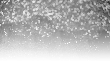 Gray glitter surface with gray light bokeh with white copyspace