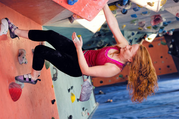 Woman Indoor Free Climbing. Indoor Rock Climbing