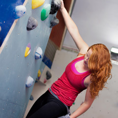 Woman Indoor Free Climbing. Indoor Rock Climbing