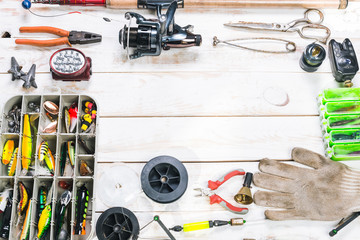 Various fisherman's equipment on wooden background