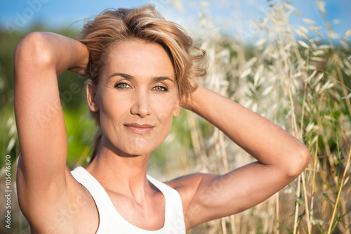 Portrait de femme blonde 40 ans dans les champs stock photo and royalty free images on fotolia - Femme blonde photo ...