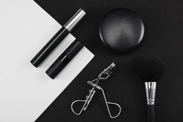 Black and white make up products in studio
