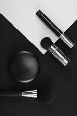 Make up arranged against black white