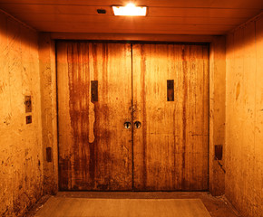 Old and rusty closed elevator doors