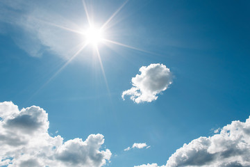 White Clouds on the blue sky with sun shines