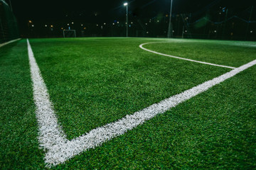 Close up of soccer or football field at night