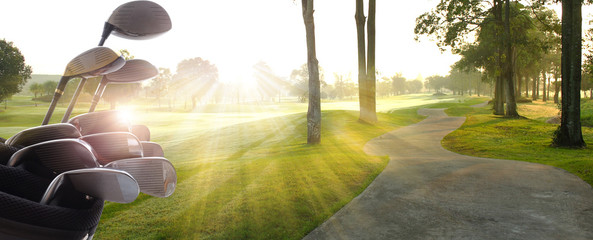 Printed roller blinds Golf Golf clubs drivers over beautiful golf course at the sunset, sunrise time.