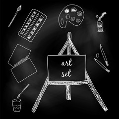 Art set. Paints, brushes, pencils, paper and easel. Sketch. White chalk on a blackboard