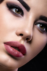 Beautiful brunette girl with arabic evening make-up and perfect skin. Beauty face. Close up