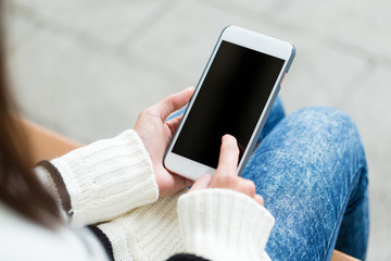 Woman touch on the screen of mobile phone