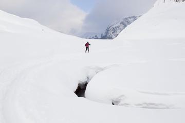 man making touring ski in French Pirenees
