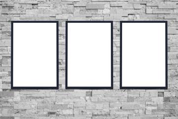three white poster on grey stone wall