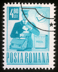 Stamp printed in Romania shows postman on round, circa 1971.