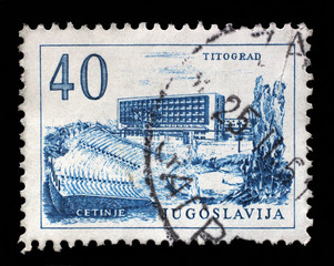 Stamp printed in Yugoslavia, shows Titograd (Podgorica) Hotel and Open-Air Theater in Cetinje, circa 1958