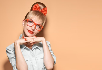 Hipster girl in stylish glasses thinking, idea
