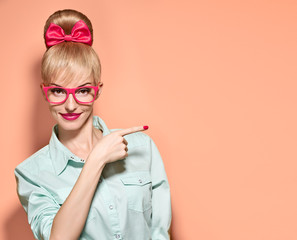 Hipster girl in stylish glasses shows finger