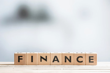 Finance sign on an office desk