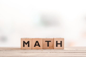 Math lesson sign on a wooden table