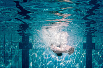 Wall Mural - Swimmer dives into the pool