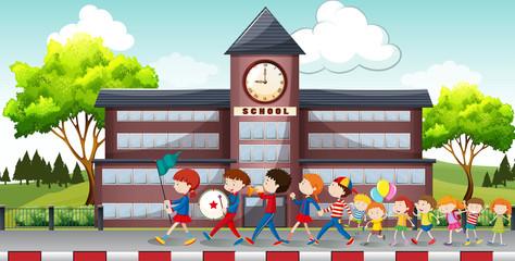 Children marching in front of school