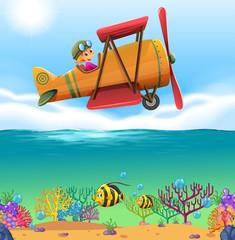 Girl flying airplane over the ocean