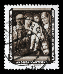 Stamp printed in DDR shows the painting Holy Family, by Andrea Mantegna , from the series Famous Paintings from Dresden Gallery, circa 1957.