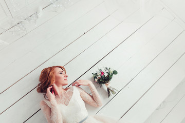 Bride lying on the floor of the whiteboard with copy space