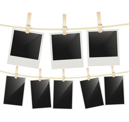 Photo frames hanging on clothesline with clothespins on white