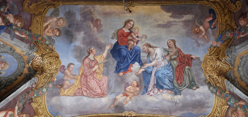 Virgin Mary with the baby Jesus surrounded by saints and angels, Franciscan Church in Ljubljana, Slovenia Wall mural