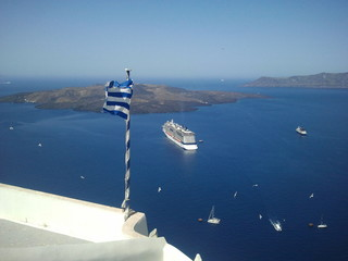 Greek flag fluttering in fira, Santorini