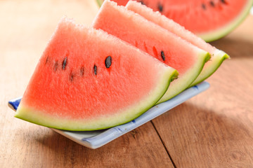 slices of watermelon on wooden background