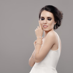 Beautiful Elegant Woman in White Dress Wearing Jewelry - Portrait of a gorgeous bride with diamond jewellery accessories