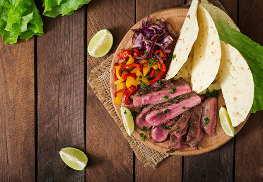 Mexican fajitas for beef steak and grilled vegetables. Top view