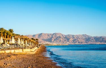 View of Eilat beach, Israel over Aqaba city, Jordan.