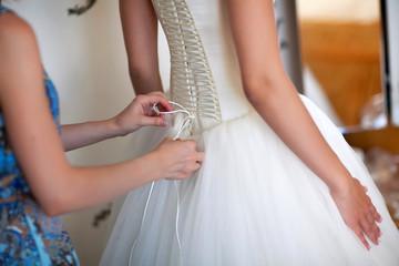 bridesmaids help the bride