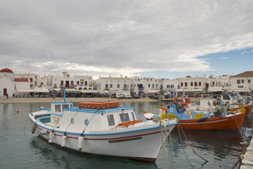 Colorful fishing and sail boats anchored on the old port in Mykonos, Cyclades, Greece