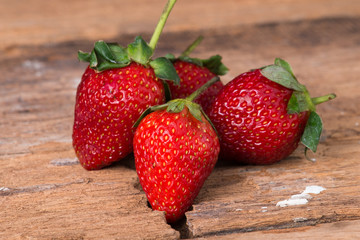 Strawberry on wooden background close up