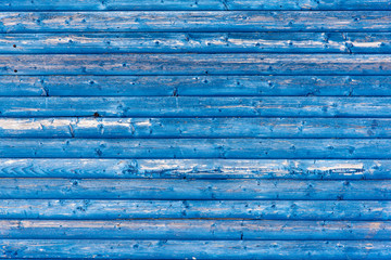 Textured blue coloured wooden panelling from a beach hut.  Suitable for background etc.