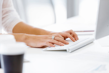Female hands typing on the keyboard