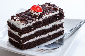Close up of Black forest cake on white background