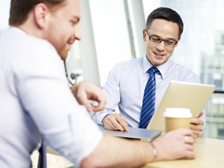 two business executive talking in office