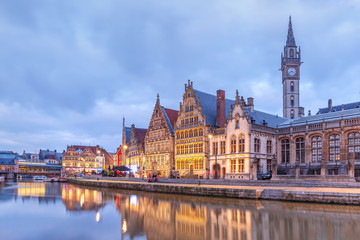 Picturesque medieval buildings on the quay Graslei and Leie river at Ghent town in the evening, Belgium