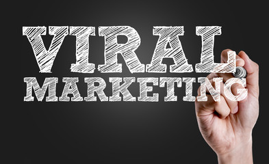 Hand writing the text: Viral Marketing