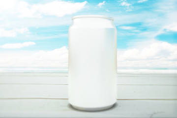 Blank can at seaside