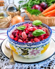Vegetable salad of cooked beets, carrots and green peas, beans, onions and olive oil.