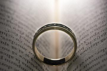 Wedding ring isolated on book pages