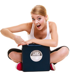 Woman with weighing scale dieting slimming.